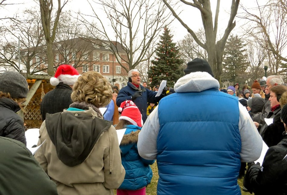 Dr. Jerry Smith leads the community singalong in Kellogg Park