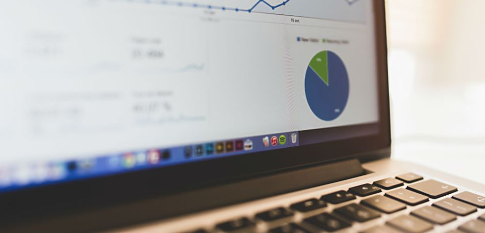 Line graph analytics and pie chart on a laptop screen