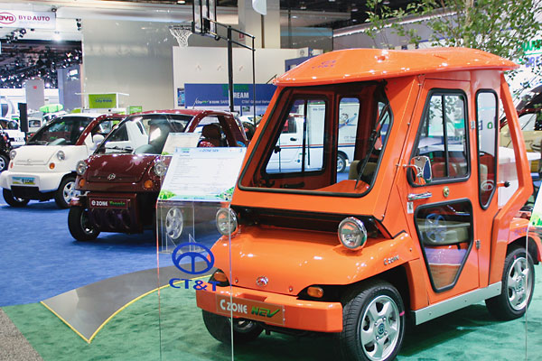 orange, white, and red CT&T mini vehicles that look like golf carts.