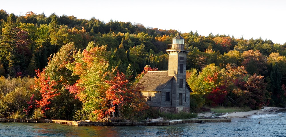 Grand Island East Channel Lighthouse surrounded by brilliant fall foilage colors