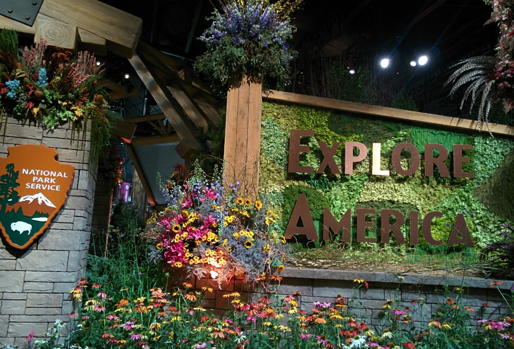 Explore America entrance at Philadelphia Flower Show 2016, surrounded by flowers and floral arrangements