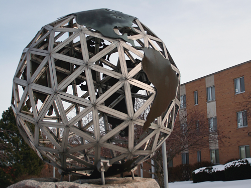 World metal sculpture in the quad