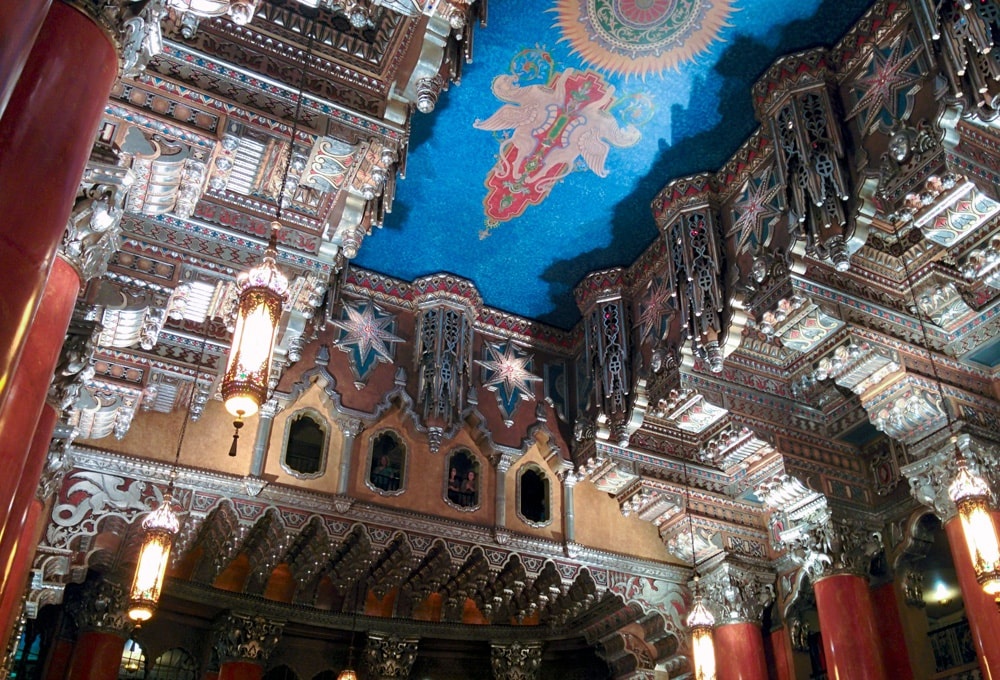 Blue ceiling with ornate artwork of the Fox Theatre lobby