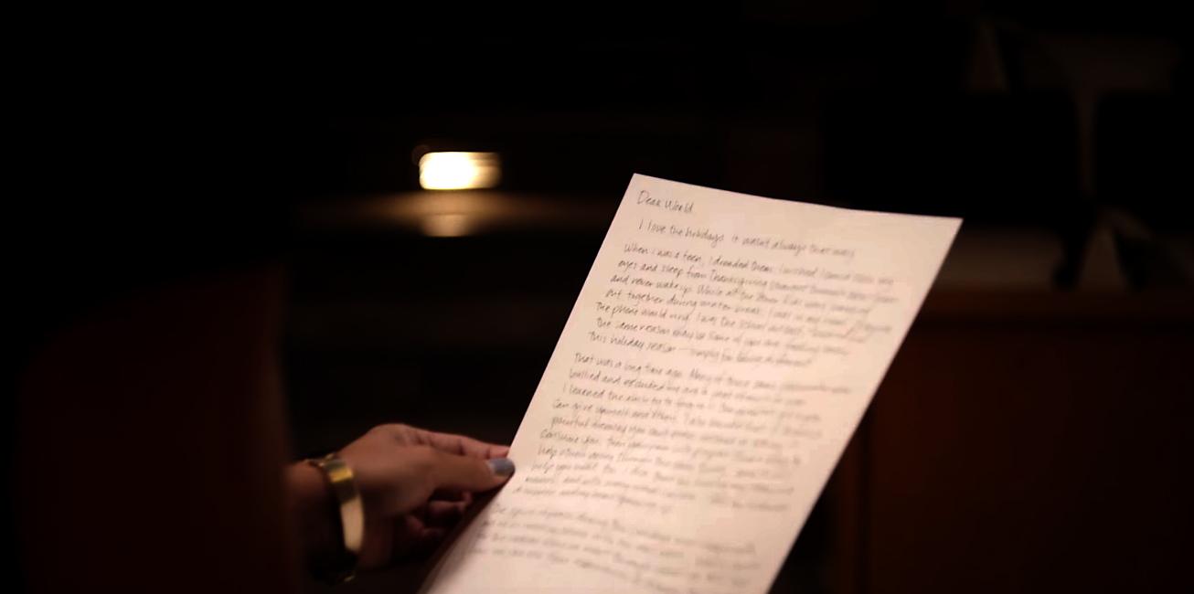 woman reading a handwritten letter