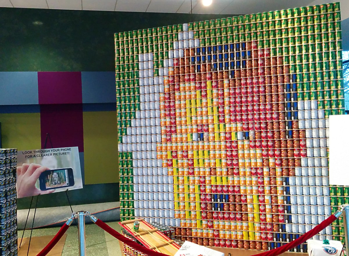 art sculpture made of different colored cans