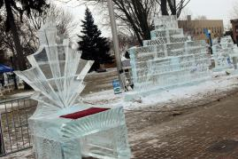 Ice throne with red seat pad and welcome ice sculpture