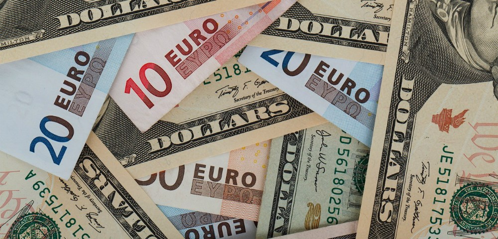 brightly colored Euro and United States currency bills.