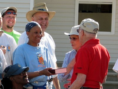 President Jimmy Carter and his wife Rosalynn Carter present Bible to Habitat homeowner