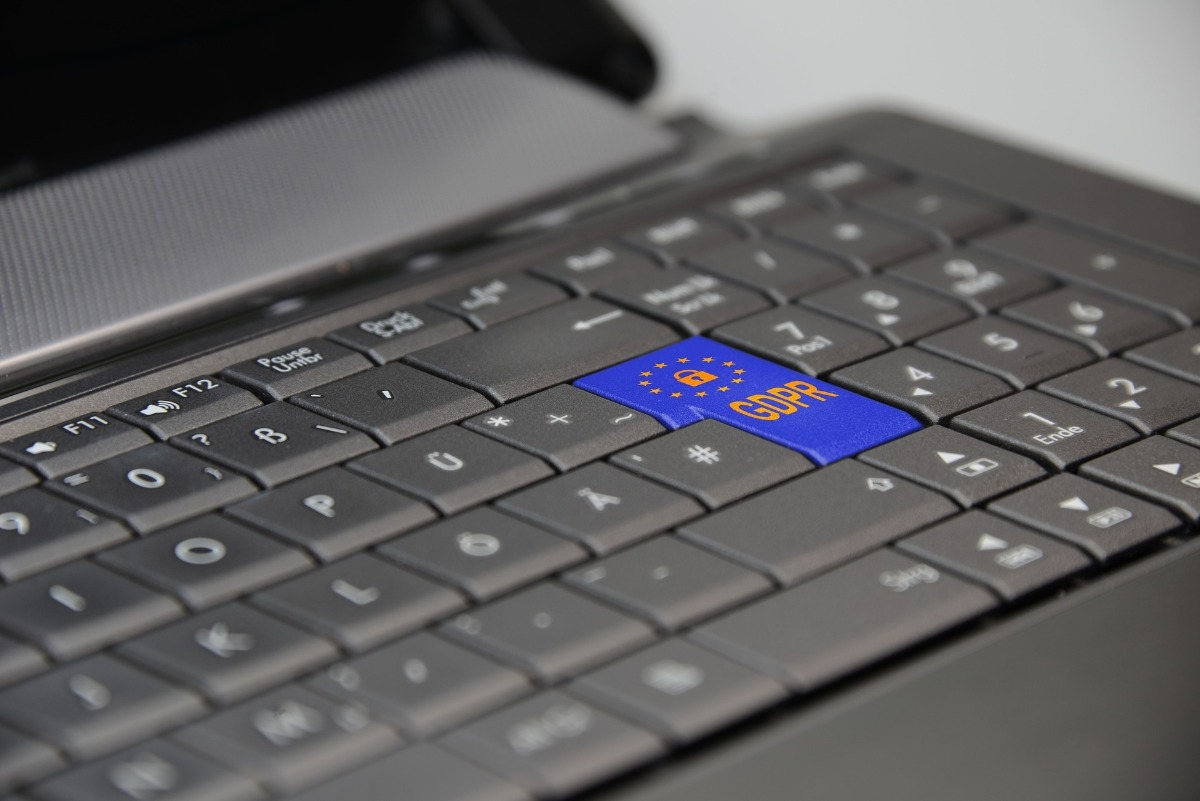 laptop keyboard with prominent blue GDPR key