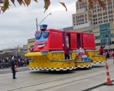 Red, yellow, and blue M-1 rail float in the 2015 Thanksgiving Day parade
