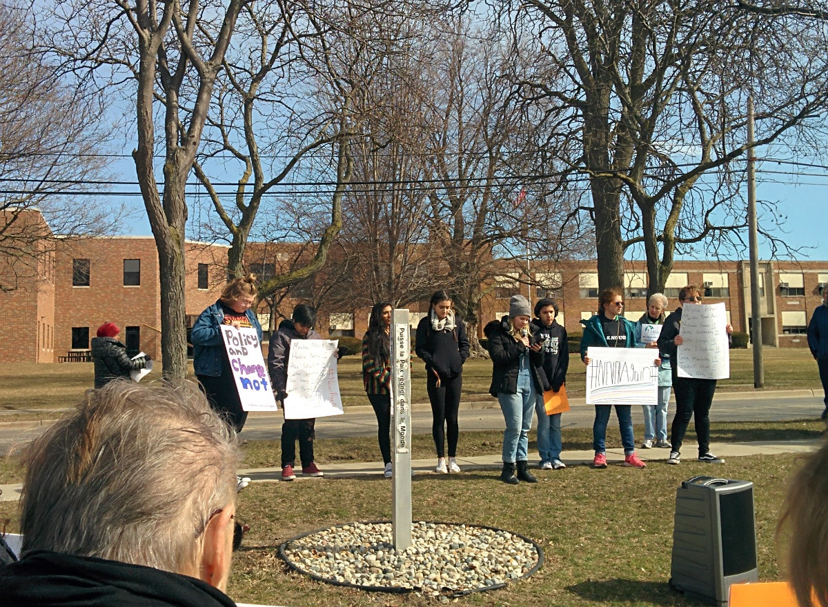 high school students, many holding protest signs, leading the march at St. Mary's Park