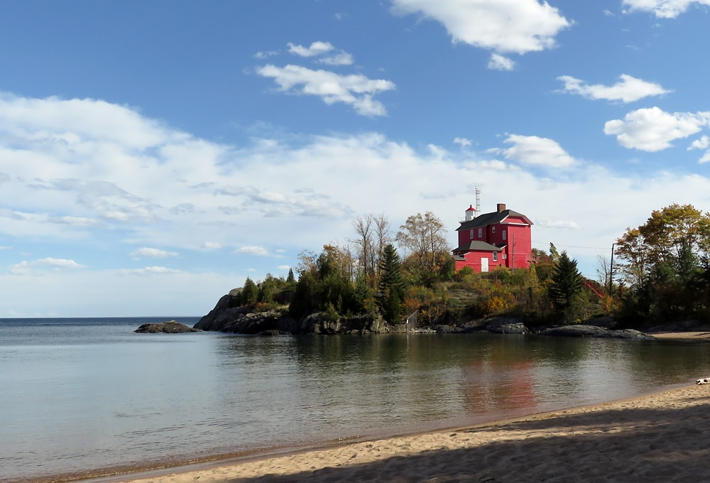 Marquette Harbor Lighthouse with beach in the foreground