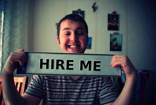 Hire me sign held by David Cohen
