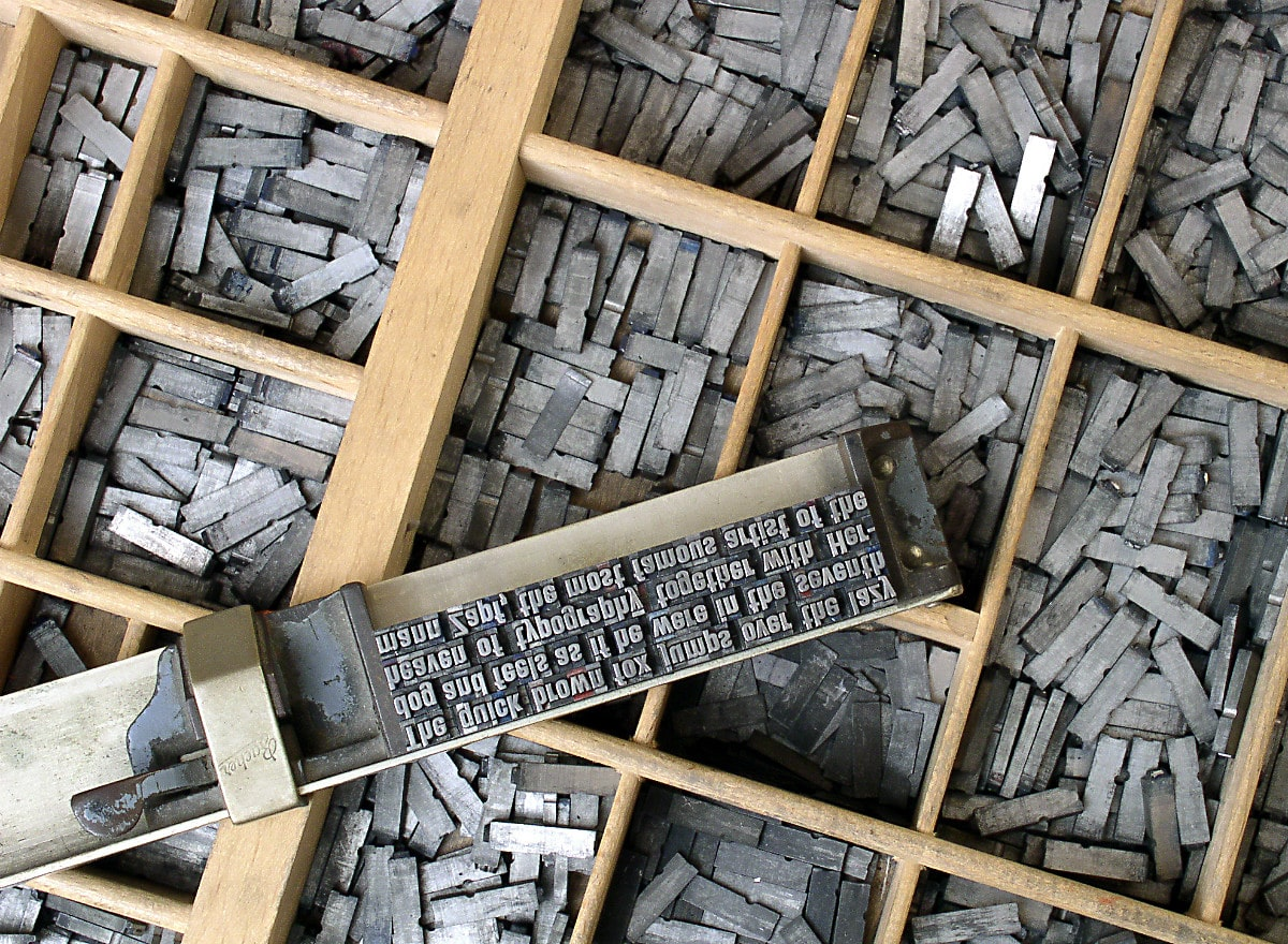 movable type in sections of wooden box.