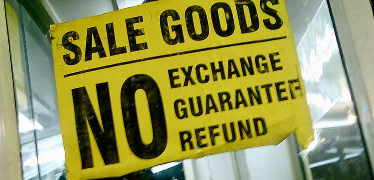 No exchange guarantee or refund on goods sign