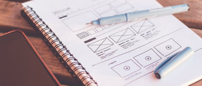 wireframe of web page in white spiral notebook