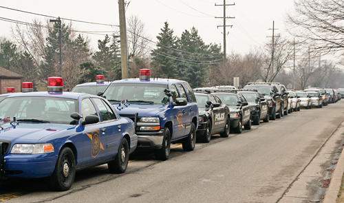 Police cars lined up on Sheldon Road