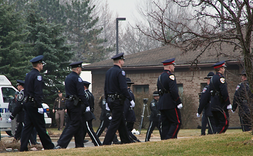 Police officers leaving the funeral service