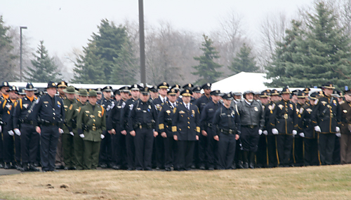 Police officers walk in formation honoring Bonnea