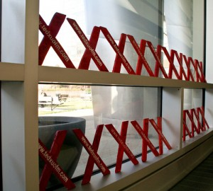 Two rows of red X's line the window sills