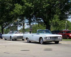 Two white convertibles cruising down Edward Hines Drive