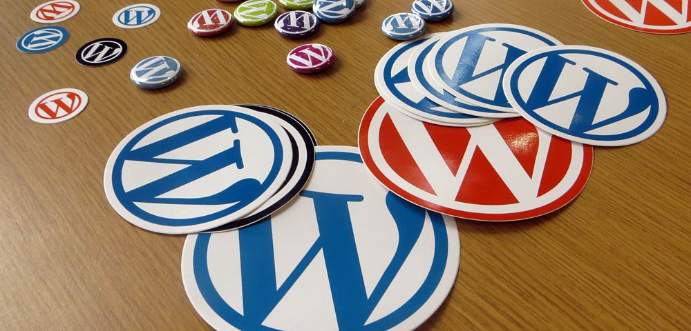 WordPress stickers on wooden table