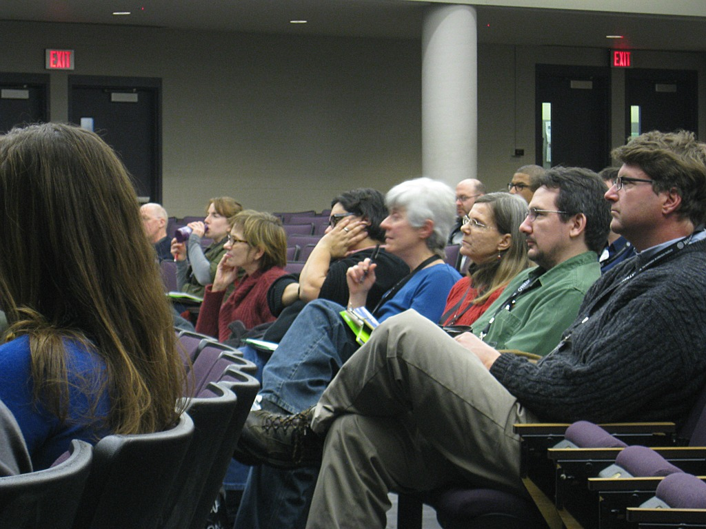 Seated in auditorium seats, attendees listen to speaker at World IA Day 2012 in Ann Arbor.