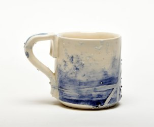 bumps and lines in blue surround this ceramic mug they are in the shop