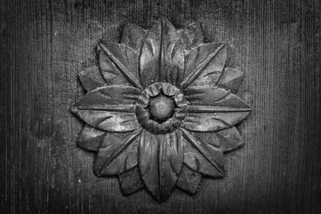 image of carved relief flowers on door representing beauty in yoga