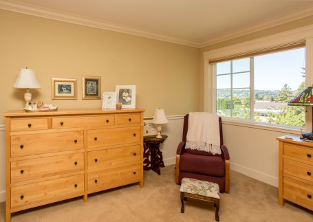 photo of corner of room with rocking chair and small table