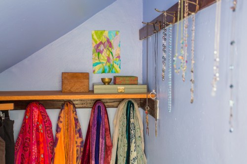 photo of new shelf, jewelry boxes, art work, necklaces