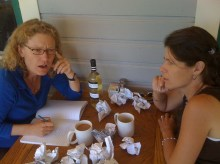 Author Lisa Jones and Friend Writing at a Table
