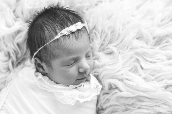 striking newborn photography of sleeping baby girl on fuzzu carpet