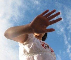 photo of hand covering face