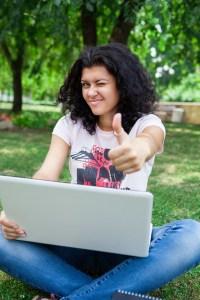 Girl on Laptop in Park