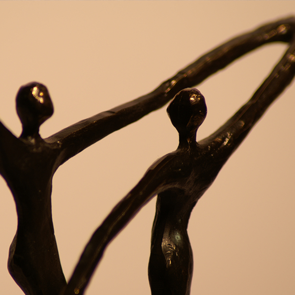 Sculpture of two bodies dancing together. Photo © FreeImages/Paulo Oliveira Santos.