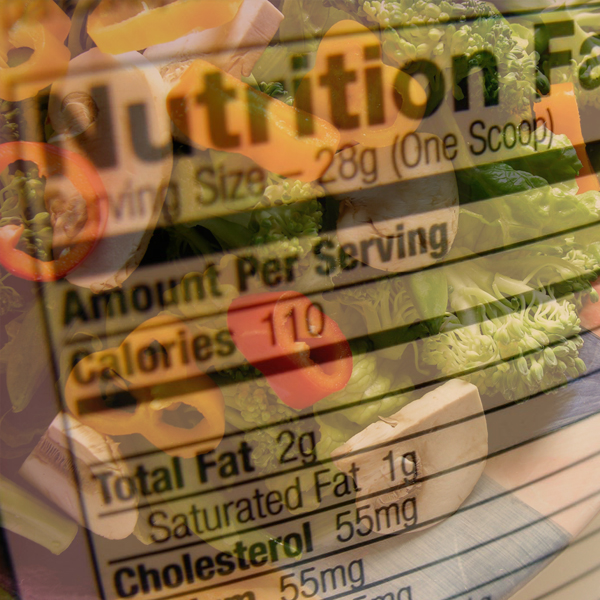 A nutrition label hovers over a salad full of colorful vegetables. Photos © FreeImages.com/Bob Smith