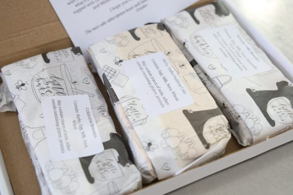 bakes by post, a white box with three packets of wrapped bakes