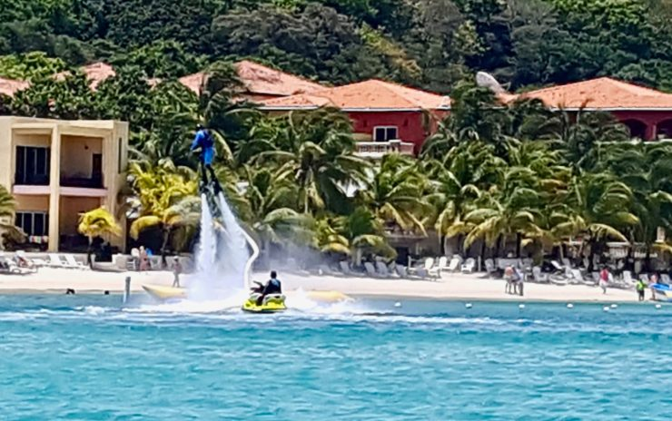 West Bay Roatan Honduras. Someone trying water jet packs at West Bay. One of many activities available on the beach.