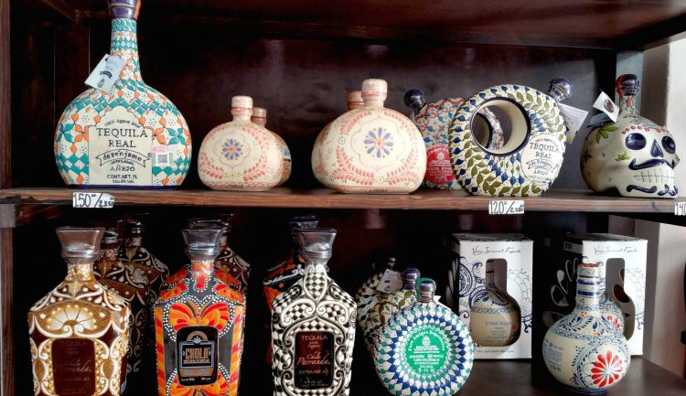 Tequilla Bottles in Mexico are like works of art! Take home a bottle when visiting Cabo San Lucas!