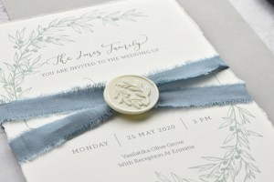 Bespoke handmade invitation with olive branch design