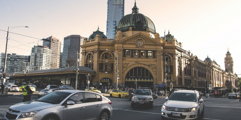 Melbourne's Flinder Street Station and busy city traffic   Little City Trips Guide to Getting Around Melbourne