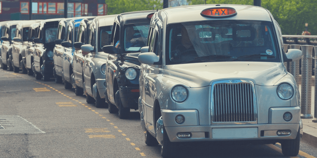 London black cabs lined up   How to get around London with Kids   London City Guide by Little City Trips