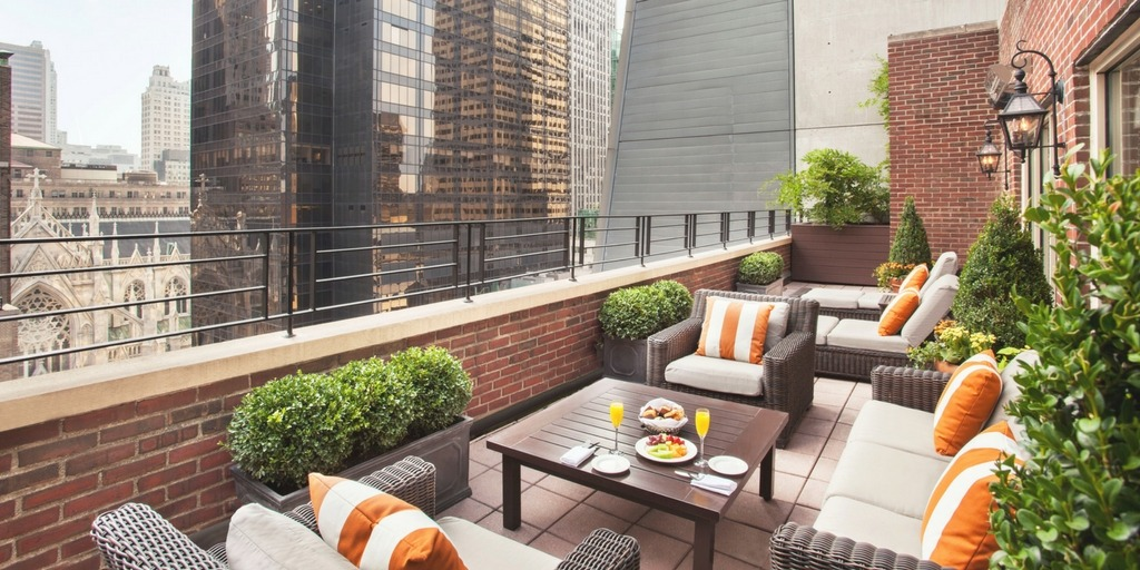 Balcony space for families at Omni Berkshire Place New York | What makes a hotel family friendly a guide by city travel experts at Little City Trips