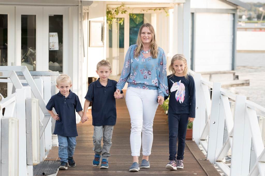Keri Hedrick - Little City Trips Editor with her family