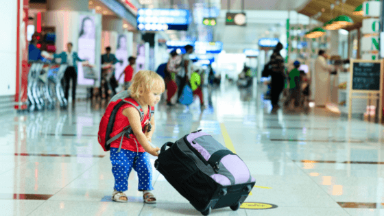 The best luggage for kids is age appropriate and not too big (in the photos,small child carrying backpack and rolling luggage)