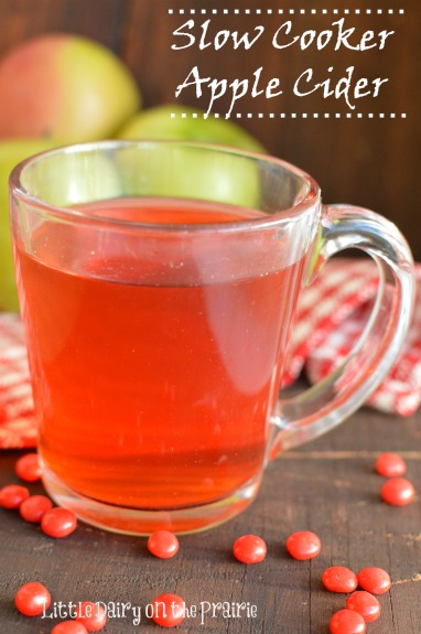 Slow Cooker Apple Cider gets it's gorgeous color and yummy flavor from red hot candies. This is so simple to make! Little Dairy on the Prairie