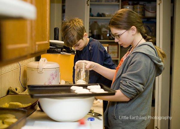 Tilly teachers Tucker to make baking powder biscuits.