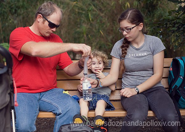 child being tube fed (g-tube) at zoo