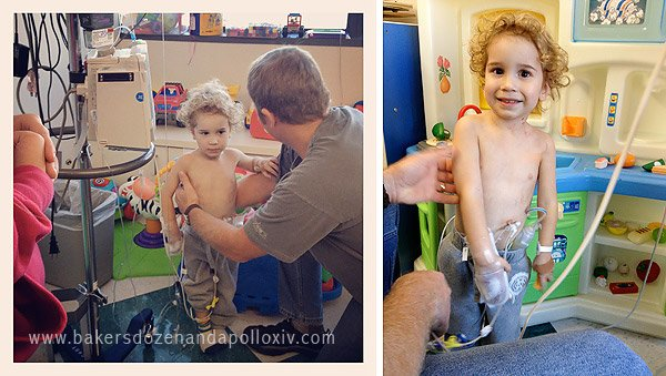 toddler hooked up to tubes in hospital